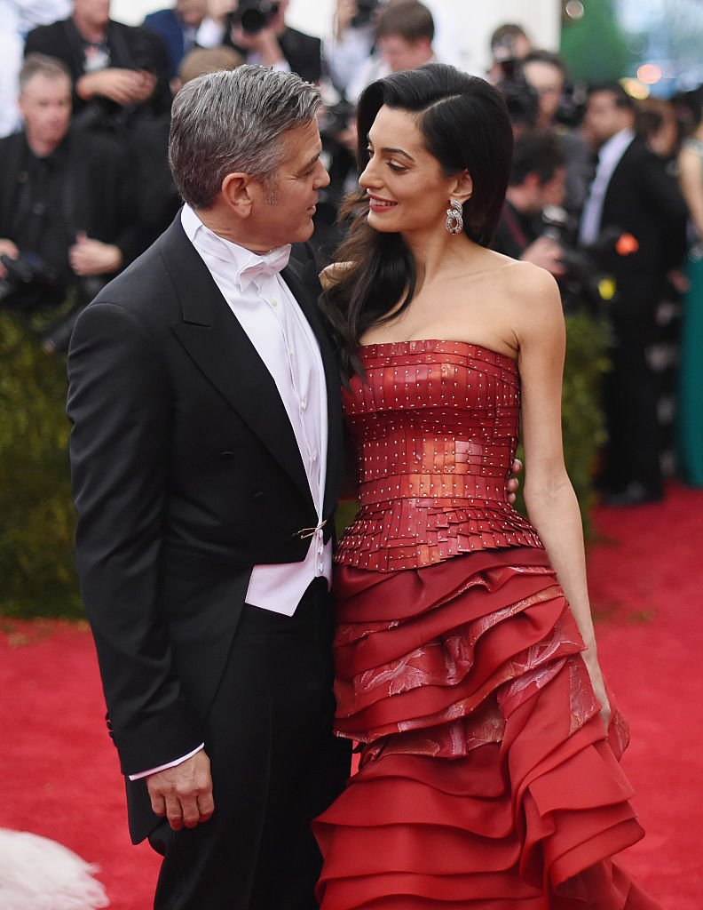 Image Source: Getty Images/George and Amal at a red carpet event