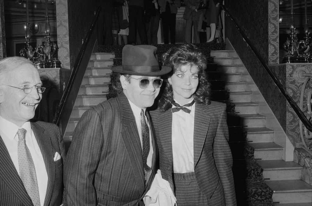 Image Credit: Getty Images / English singer and pianist Elton John with his wife Renate Blauel at the theatre, London, UK, 17th February 1985.