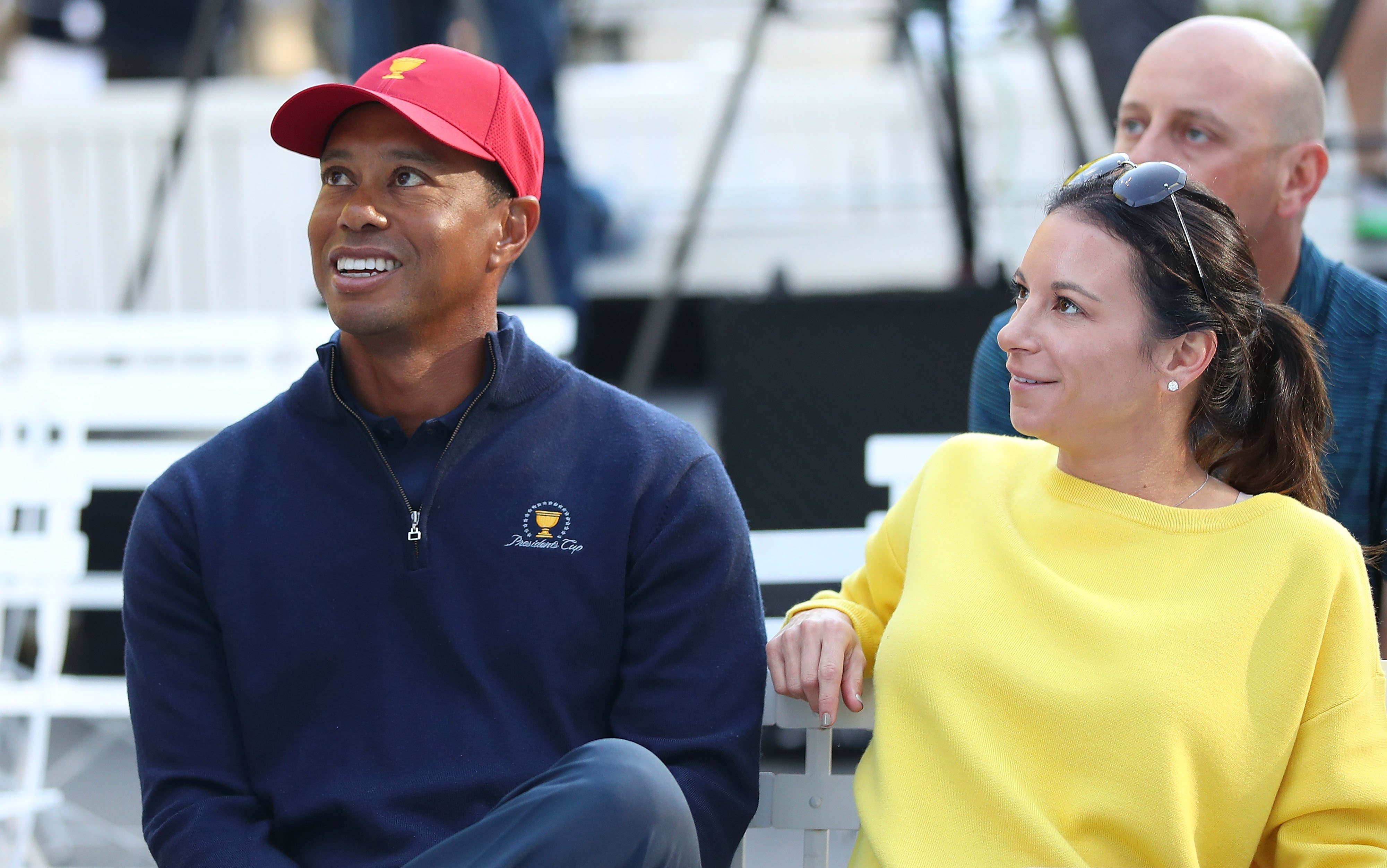 Image Credits: Getty Images / Scott Barbour | Tiger Woods and his girlfriend Erica Herman look on during a Presidents Cup media opportunity at the Yarra Promenade on December 5, 2018 in Melbourne, Australia. The Presidents Cup 2019 will be held on December 9-15, 2019, when it returns to the prestigious Royal Melbourne Golf Club in Australia.