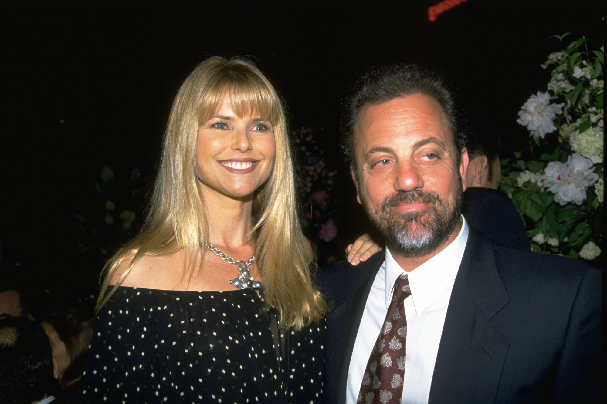 Image Credits: Getty Images / Diane Freed / Liaison | Billy Joel and Christie Brinkley, who are now divorced, stand together in New York City in this undated photo.