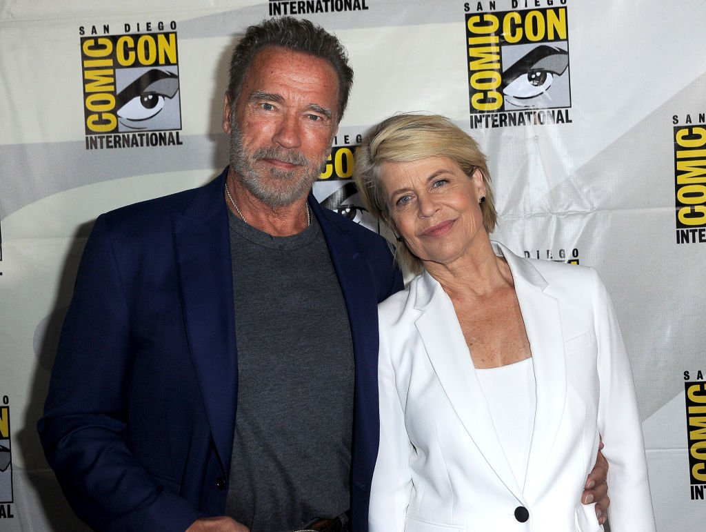 "Image Credits: Getty Images / Albert L. Ortega | Arnold Schwarzenegger and Linda Hamilton attend the ""Terminator: Dark Fate"" panel during 2019 Comic-Con International at San Diego Convention Center on July 18, 2019 in San Diego, California."