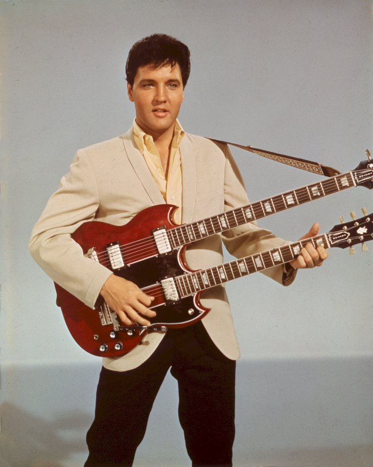 Image Credit: Getty Images / Elvis Presley at a photo shoot.