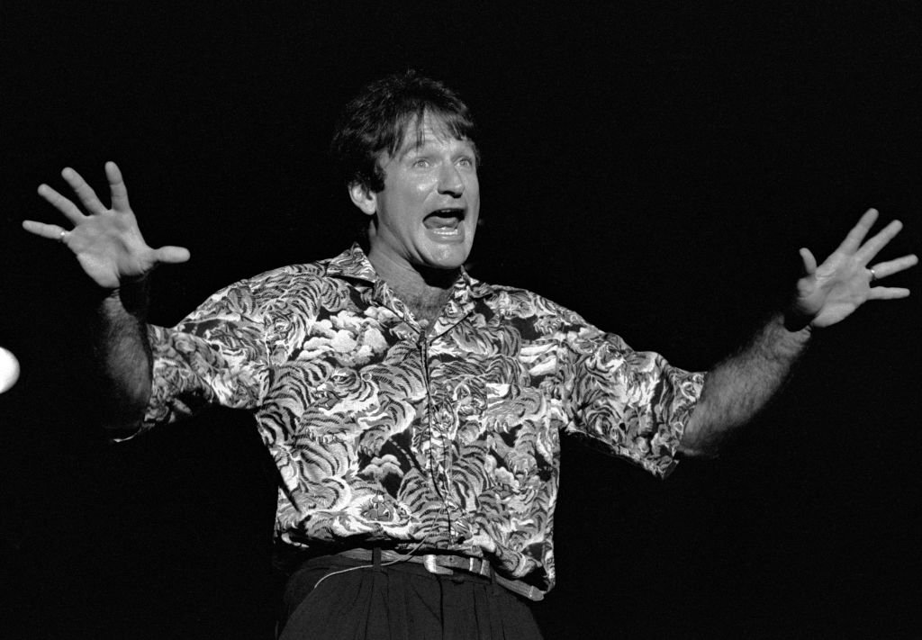Image Credits: Getty Images / Rick Diamond | Comedian Robin Williams performs at Chastain Park Amphitheater in Atlanta Georgia. May 10, 1986.