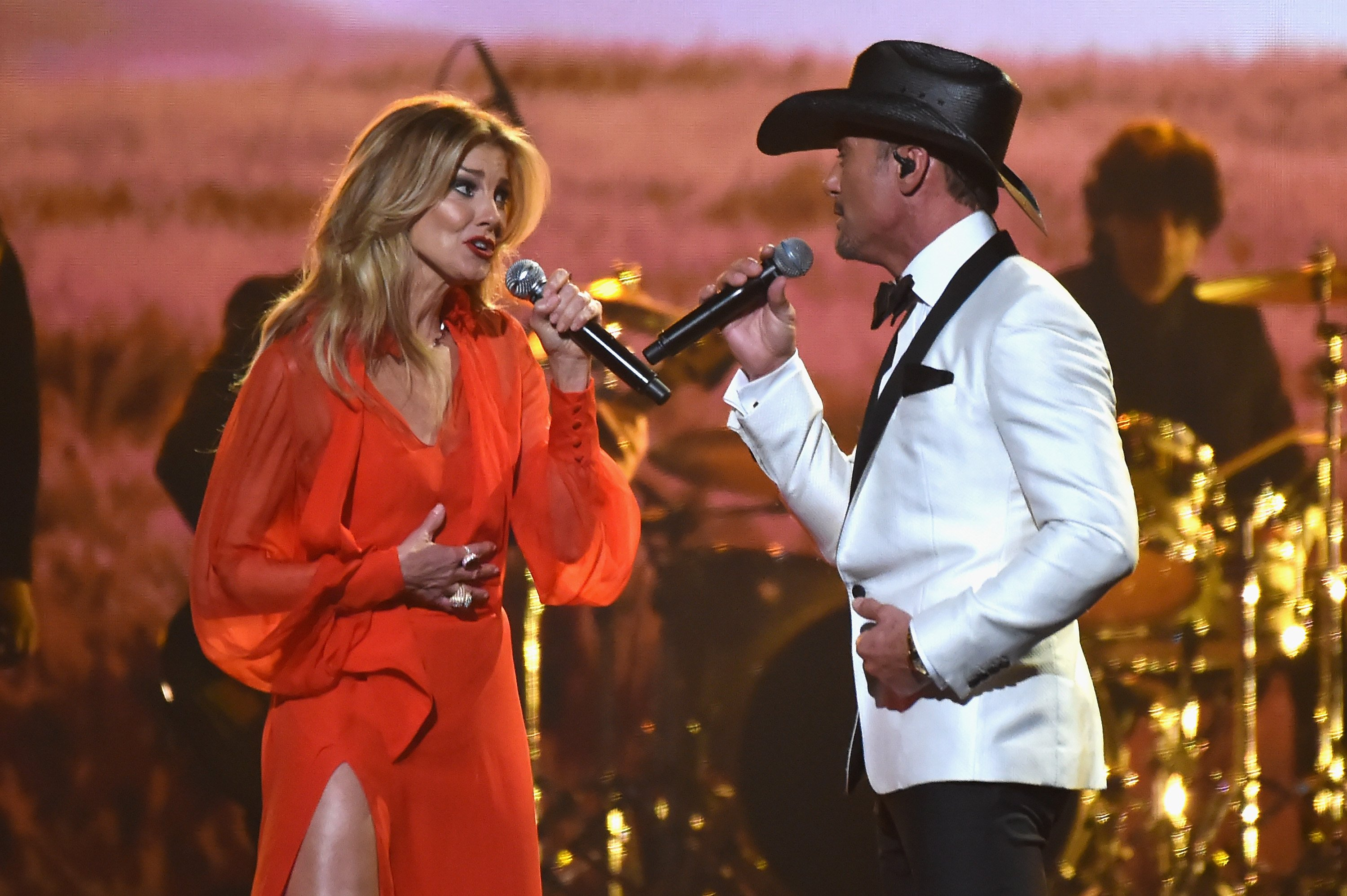 Image Credits: Getty Images / Rick Diamond | Faith Hill and Tim McGraw perform onstage at the 51st annual CMA Awards at the Bridgestone Arena on November 8, 2017 in Nashville, Tennessee.