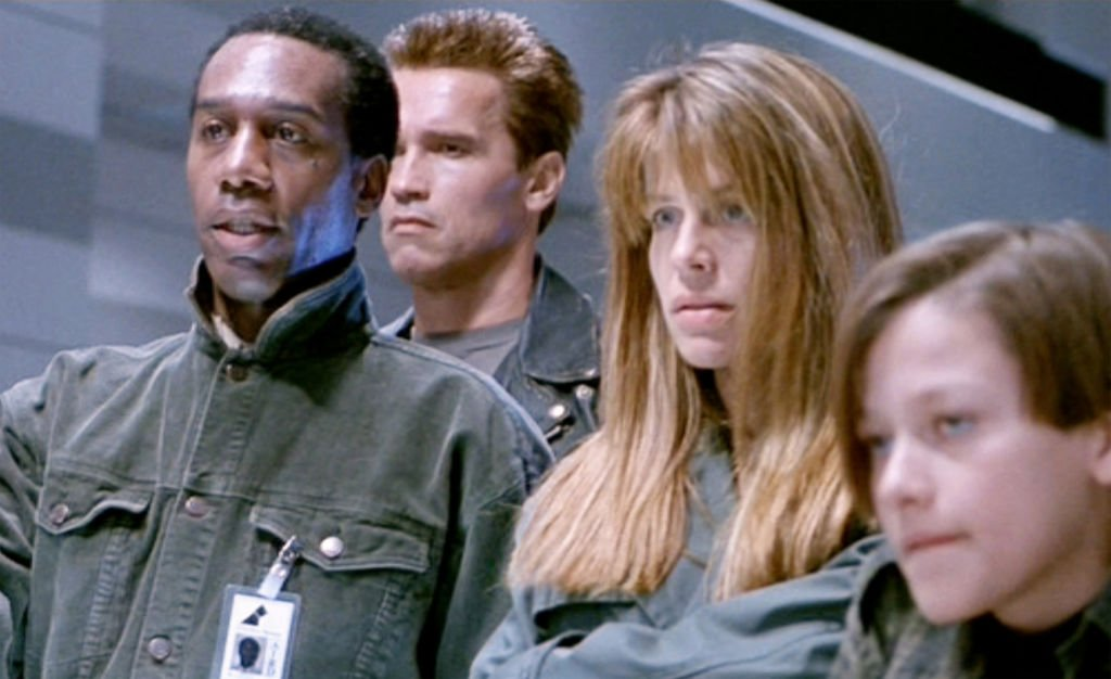 "Image Credits: Getty Images / CBS / Paramount Pictures | The movie ""Terminator 2: Judgment Day"", (alt: T2) directed by James Cameron. Seen here from left, Joe Morton (as Miles Dyson), Arnold Schwarzenegger (as the T-800 Terminator), Linda Hamilton (as Sarah Connor) and Edward Furlong (as John Connor). Theatrical wide release July 3, 1991."
