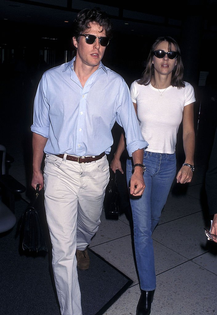 Image Source: Getty Images/Ron Galella, Ltd./Actor Hugh Grant and actress Elizabeth Hurley depart for New York City on November 6, 1997 at Los Angeles International Airport in Los Angeles, California