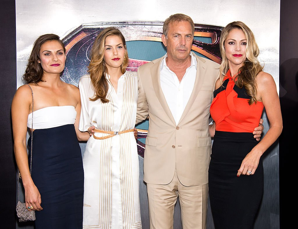 "Image Credit: Getty Images / Annie Costner, Lily Costner, actor Kevin Costner and wife Christine Baumgartner attend ""Man Of Steel"" World Premiere at Alice Tully Hall at Lincoln Center on June 10, 2013."