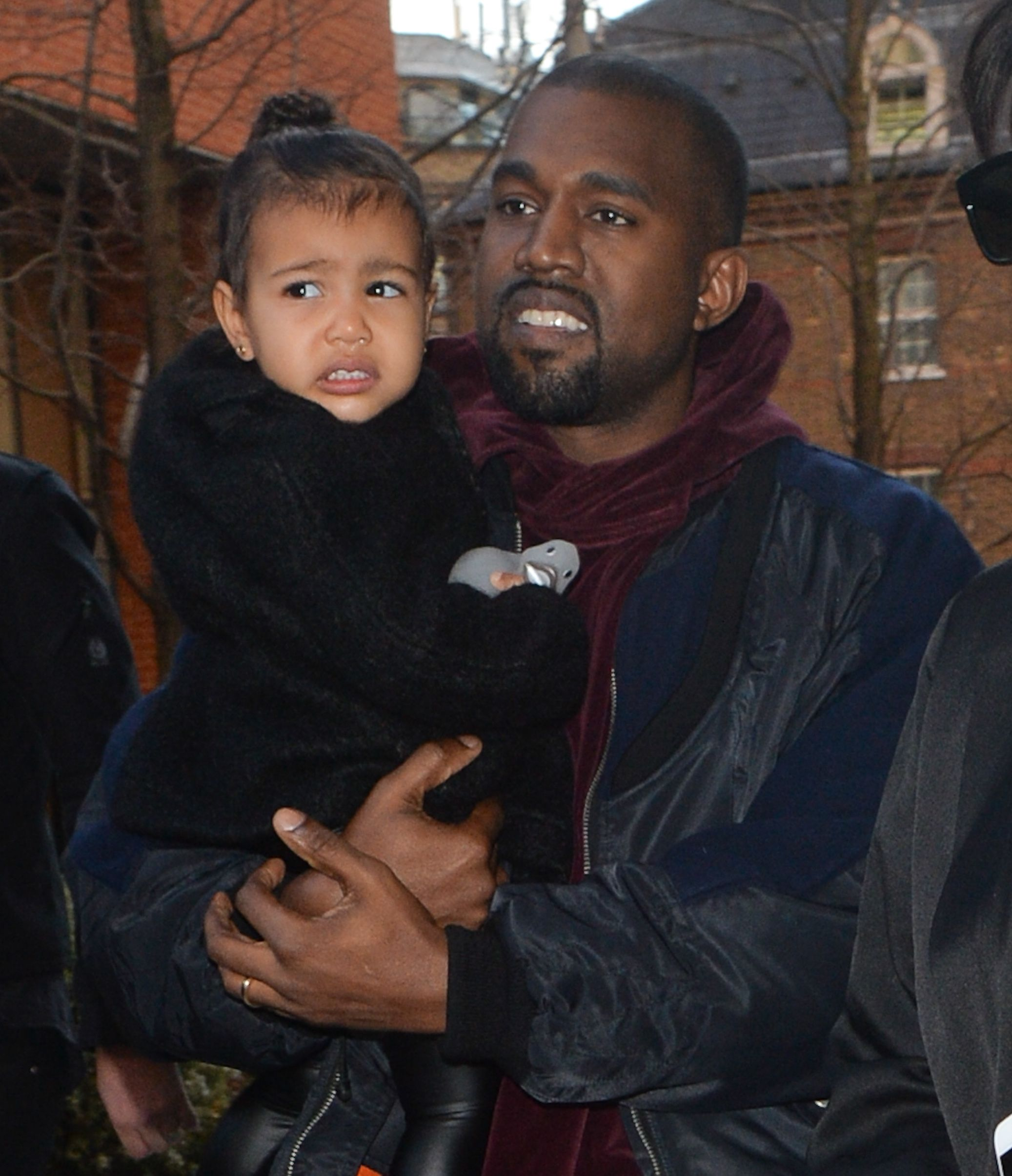 Kanye West with baby North at a play centre in Battersea / Getty Images