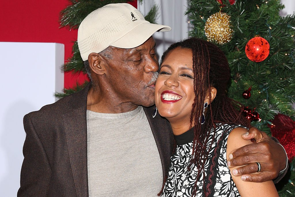 "Image Source: Getty Images/Paul Archuleta| Actor Danny Glover (L) and his Wife Elaine Cavalleiro (R) attend the premiere of ""Almost Christmas"" at Regency Village Theatre on November 3, 2016 in Westwood, California"