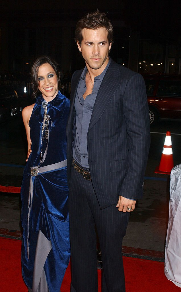 "Image Source: Getty Images/Albert L. Ortega/Alanis Morissette and Ryan Reynolds during ""Blade: Trinity"" Los Angeles Premiere - Arrivals at Grauman's Chinese Theater in Hollywood, California"