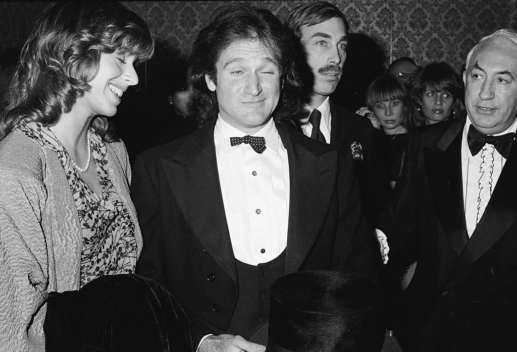 Image Credits: Getty Images / Fotos International / Frank Edwards | American comedian and actor Robin Williams (center) and his wife Valerie Velardi backstage at the Golden Globes Awards held at the Beverly Hilton, Beverly Hills, California, January 27, 1979.