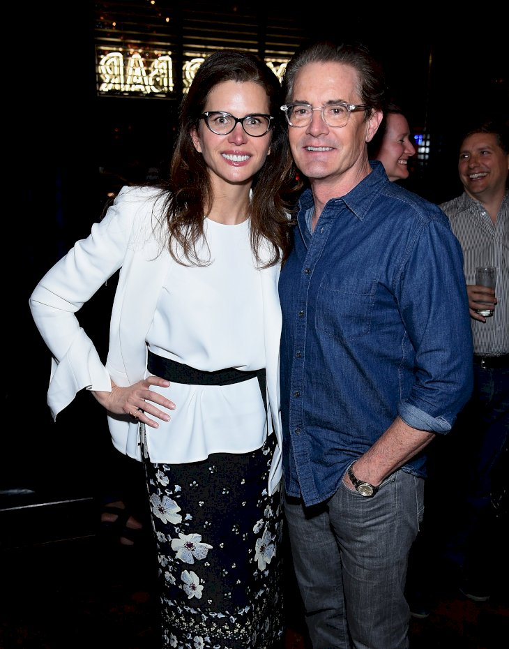 "Image Credit: Getty Images/Dimitrios Kambouris | Desiree Gruber and Kyle MacLachlan attend the after party for A Screening Of ""Impulse"""