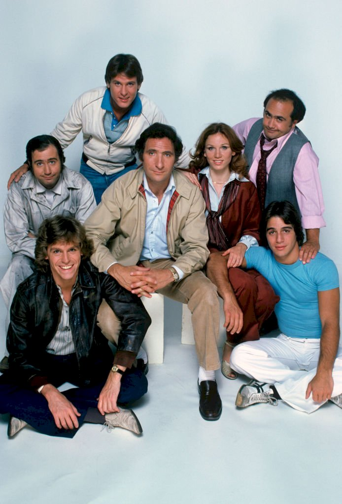 Image Credits: Getty Images / Taxi cast: Andy Kaufman (as Latka), Jeff Conaway (as Bobby), Randall Carver (as John), Judd Hirsch (as Alex), Marilu Henner (as Elaine), Danny DeVito (as Louie) and Tony Danza (as Tony)