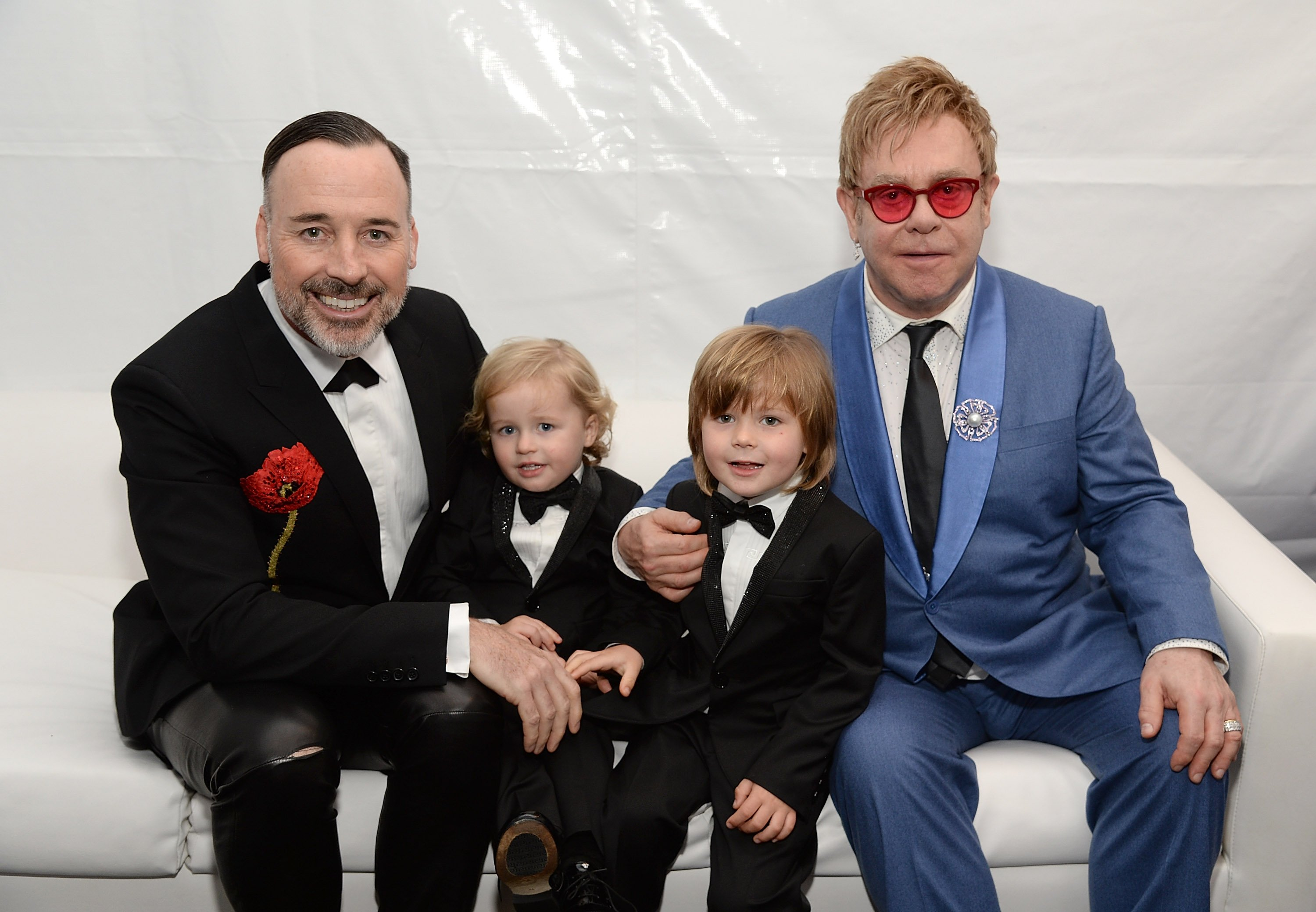 Image Credits: Getty Images / Elton John and David Furnish pose along with their children.
