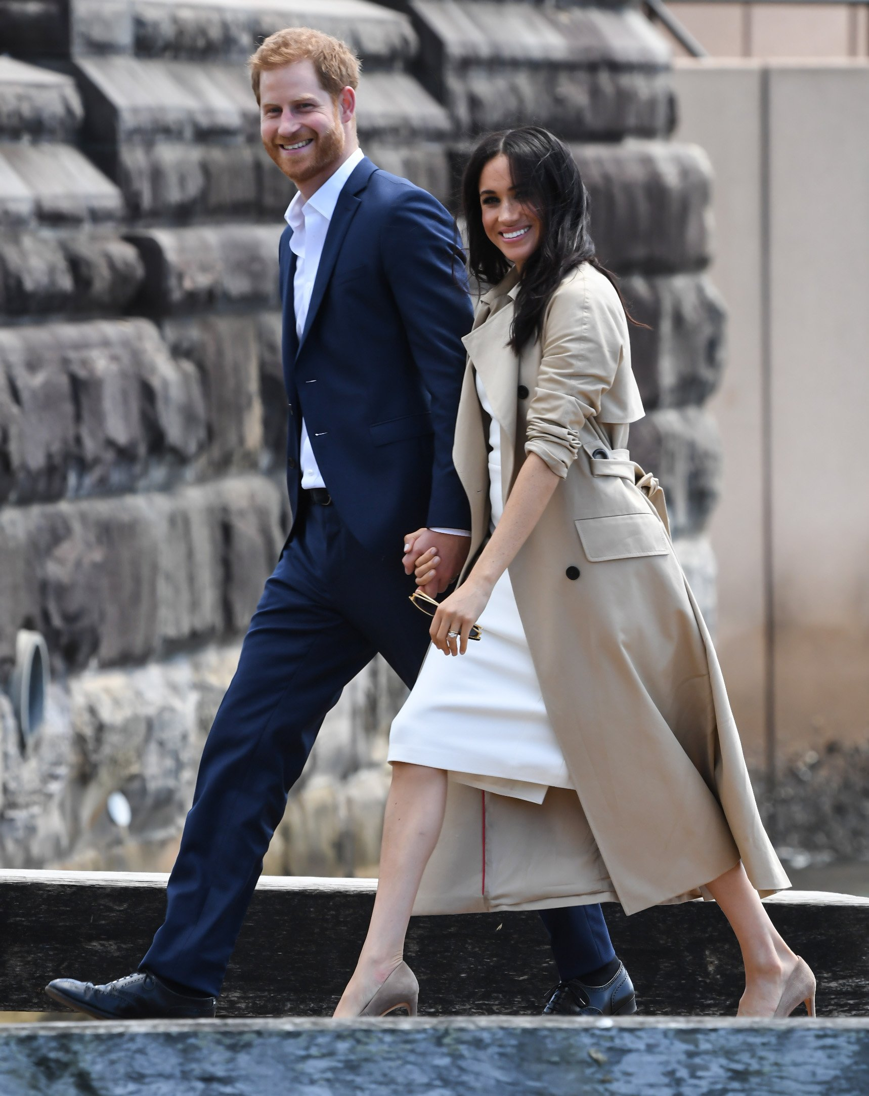 Image Credits: Getty Images / James D. Morgan   Prince Harry, Duke of Sussex and Meghan, Duchess of Sussex arrive at Man o'War Steps, a wharf next to the Opera House on October 16, 2018 in Sydney, Australia. The Duke and Duchess of Sussex are on their official 16-day Autumn tour visiting cities in Australia, Fiji, Tonga and New Zealand.