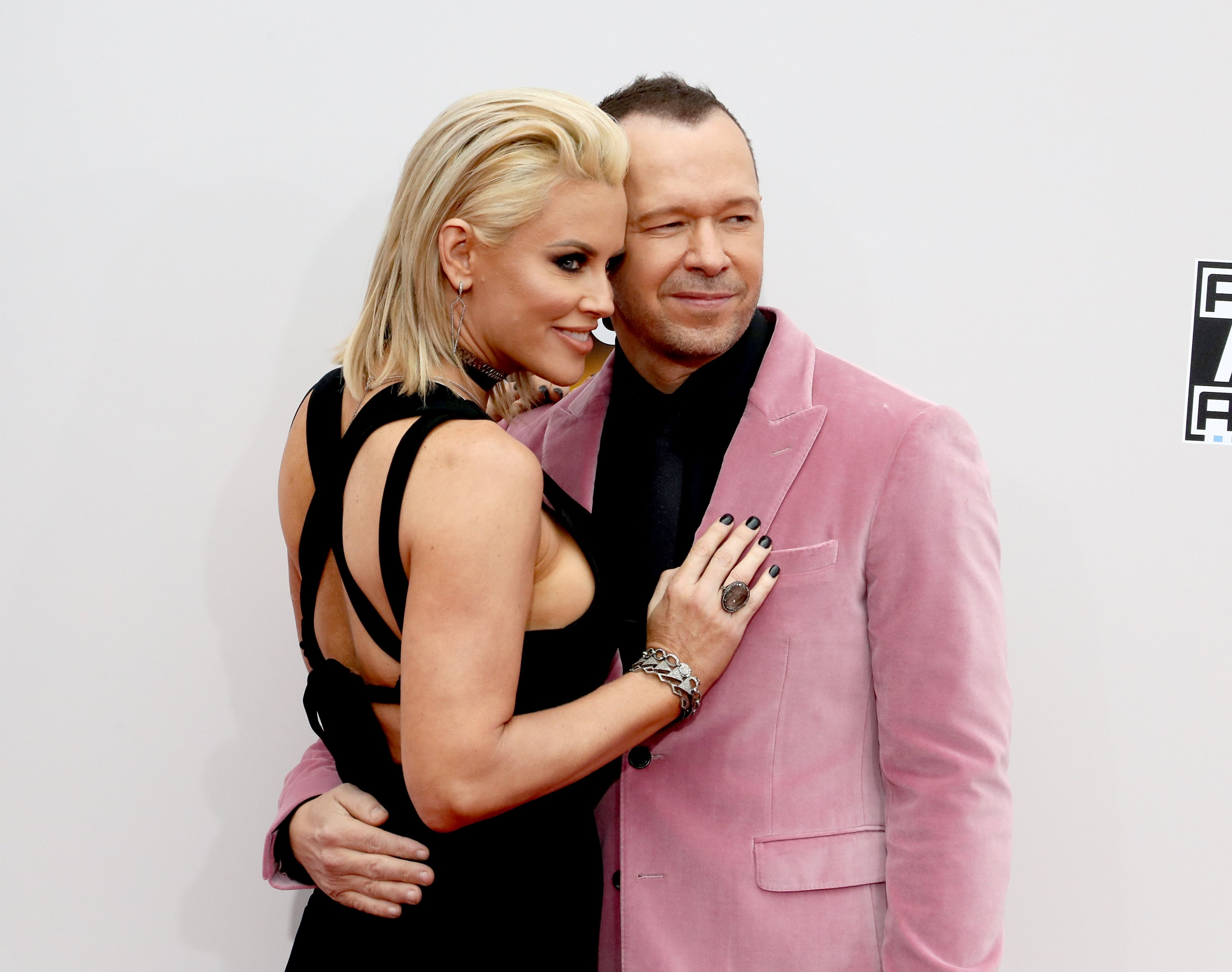 Image Credit: Getty Images/David Livingston | Jenny McCarthy and Donnie Wahlberg attend the 2016 American Music Awards