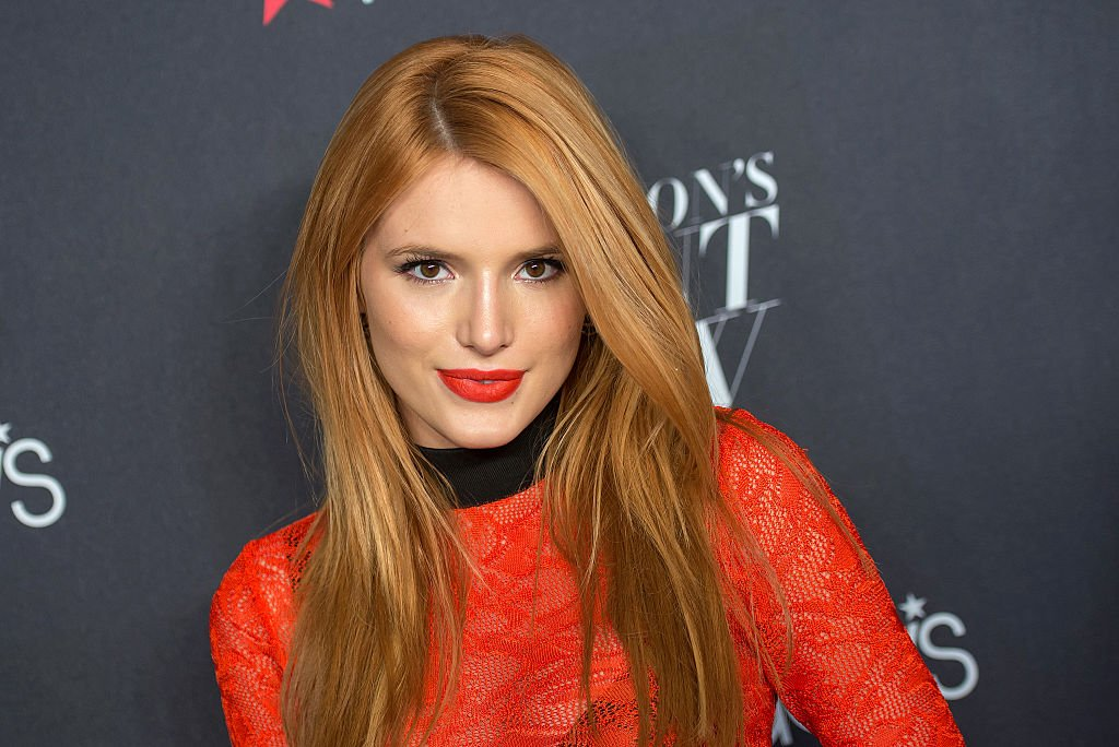 Image Credit: Getty Images / Actress and Disney star, Bella Thorne poses for a picture on the red carpet.