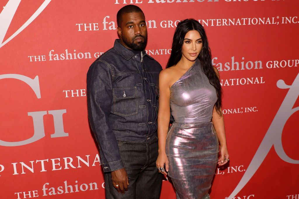 Kanye West and his wife Kim Kardashian West / Getty Images