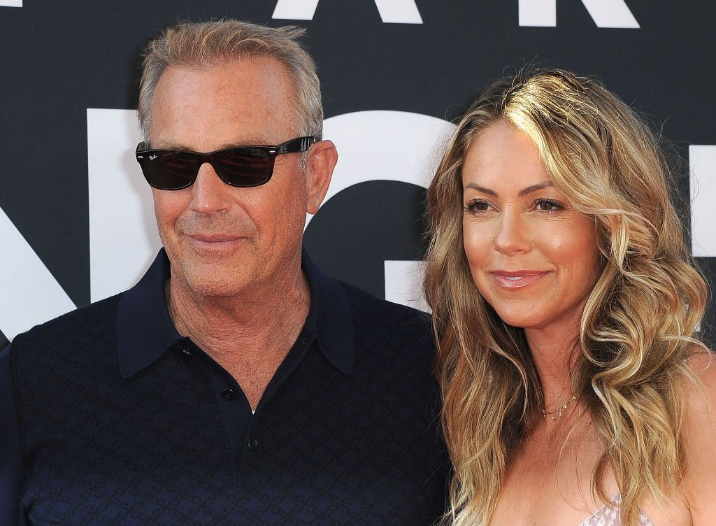 "Image Credit: Getty Images / Kevin Costner and wife Christine Baumgartner arrive for the Premiere Of 20th Century Fox's ""The Art Of Racing In The Rain"" held at El Capitan Theatre on August 1, 2019."