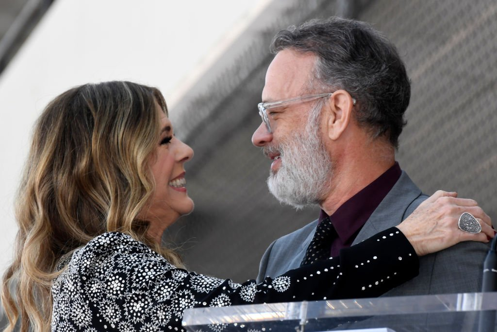 Image Credits: Getty Images / Frazer Harrison | Rita Wilson and Tom Hanks embrace as Wilson is honored with a star on the Hollywood Walk of Fame on March 29, 2019 in Hollywood, California.