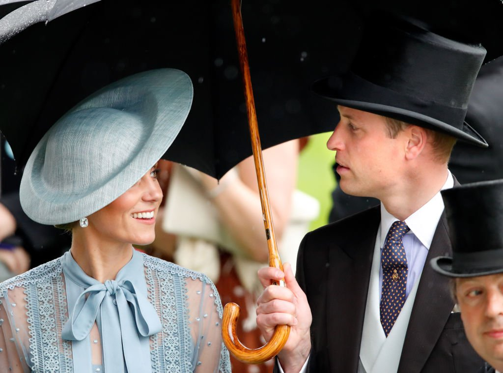 Image Credit: Getty Images / Catherine, Duchess of Cambridge and Prince William, Duke of Cambridge shelter under an umbrella as they attend day one of Royal Ascot at Ascot Racecourse on June 18, 2019 in Ascot, England.