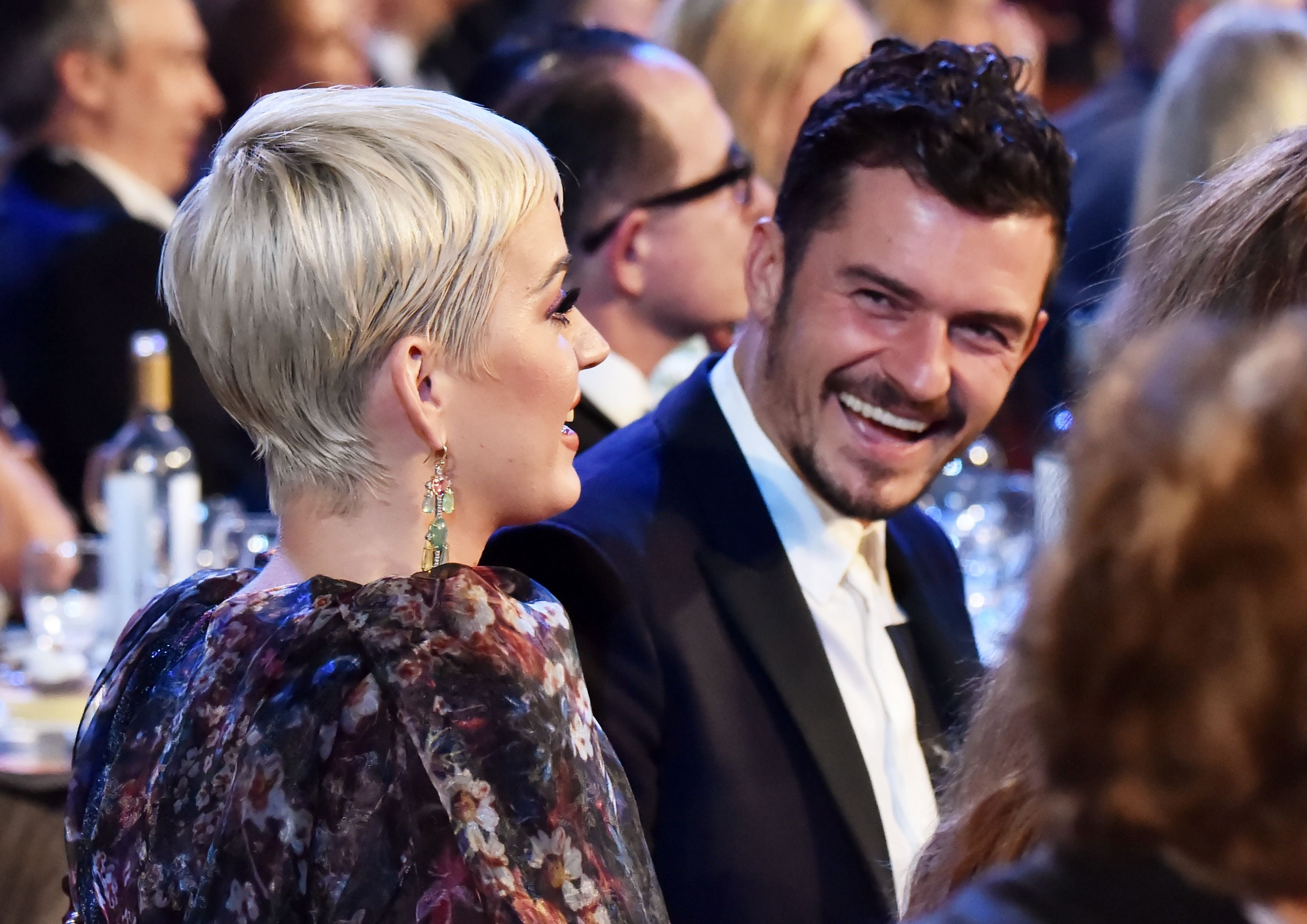 Katy Perry (L) and Orlando Bloom attend MusiCares Person of the Year honoring Dolly Parton / Getty Images