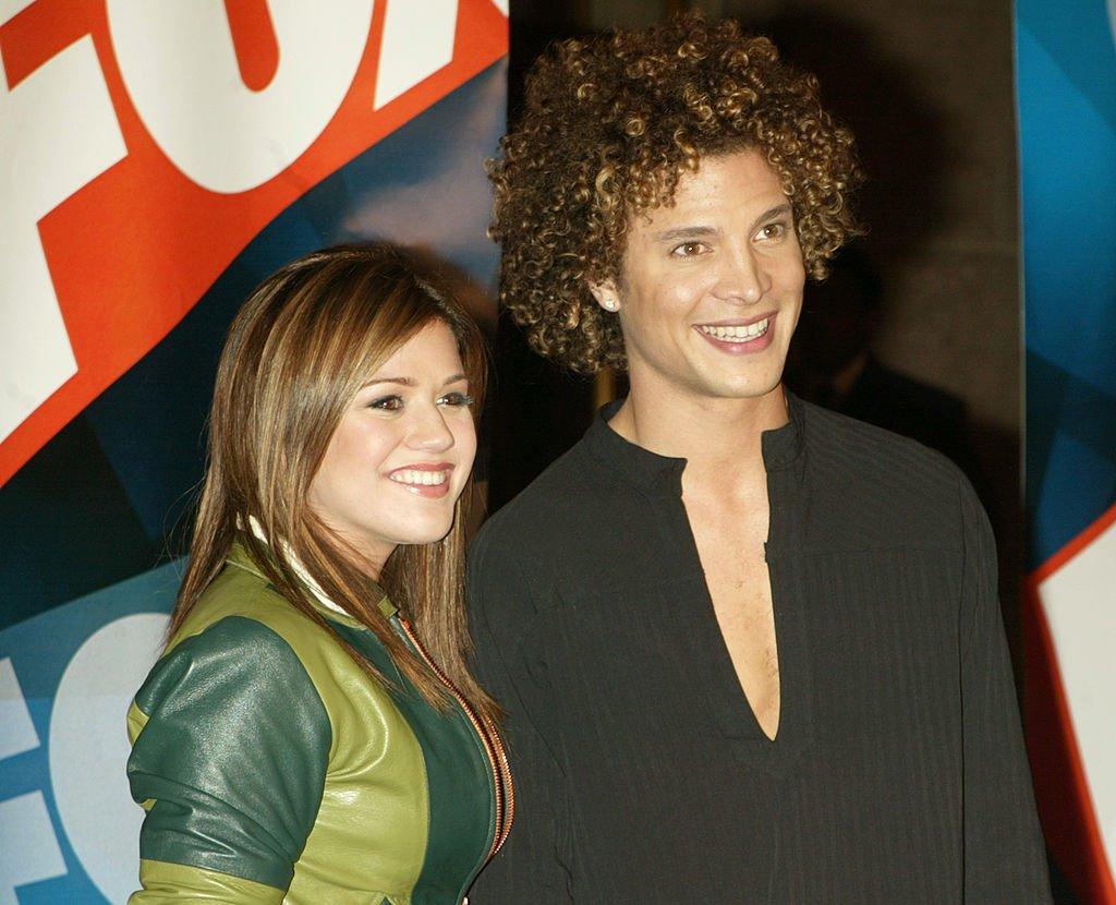 Image Credit: Getty Images / American Idol contestants Justin Guarini and Kelly Clarkson at a Fox party.