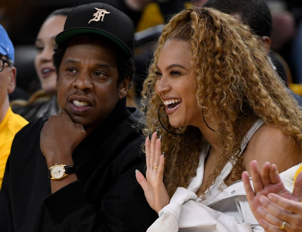 Image Credit: Getty Images / Jay-Z and Beyonce sit court side at Oracle Arena in Oakland, Calif., on Saturday, April 28, 2018.