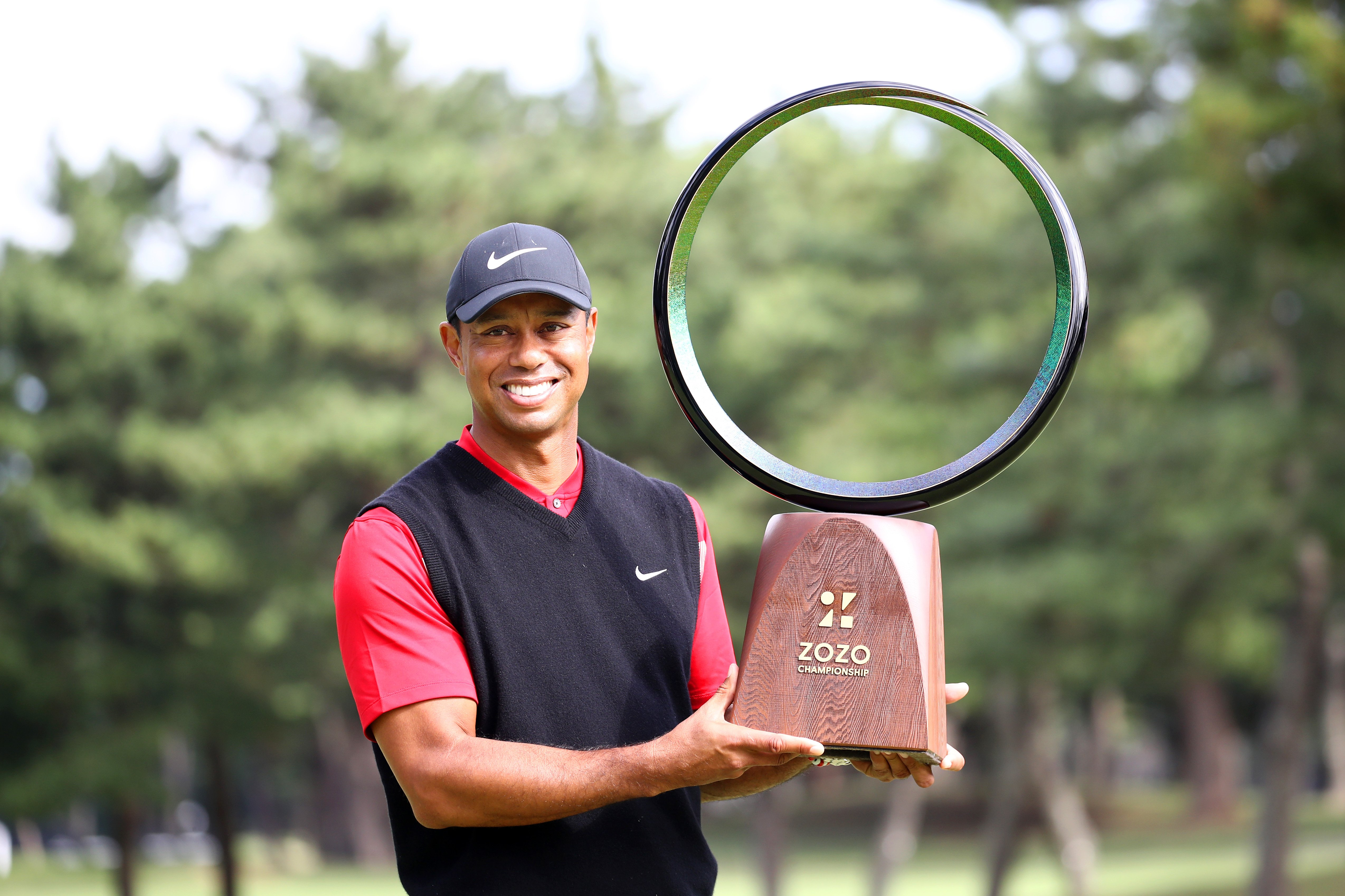 Image Credits: Getty Images / Chung Sung-Jun | Tiger Woods of the United States poses with the trophy after the award ceremony following the final round of the Zozo Championship at Accordia Golf Narashino Country Club on October 28, 2019 in Inzai, Chiba, Japan.