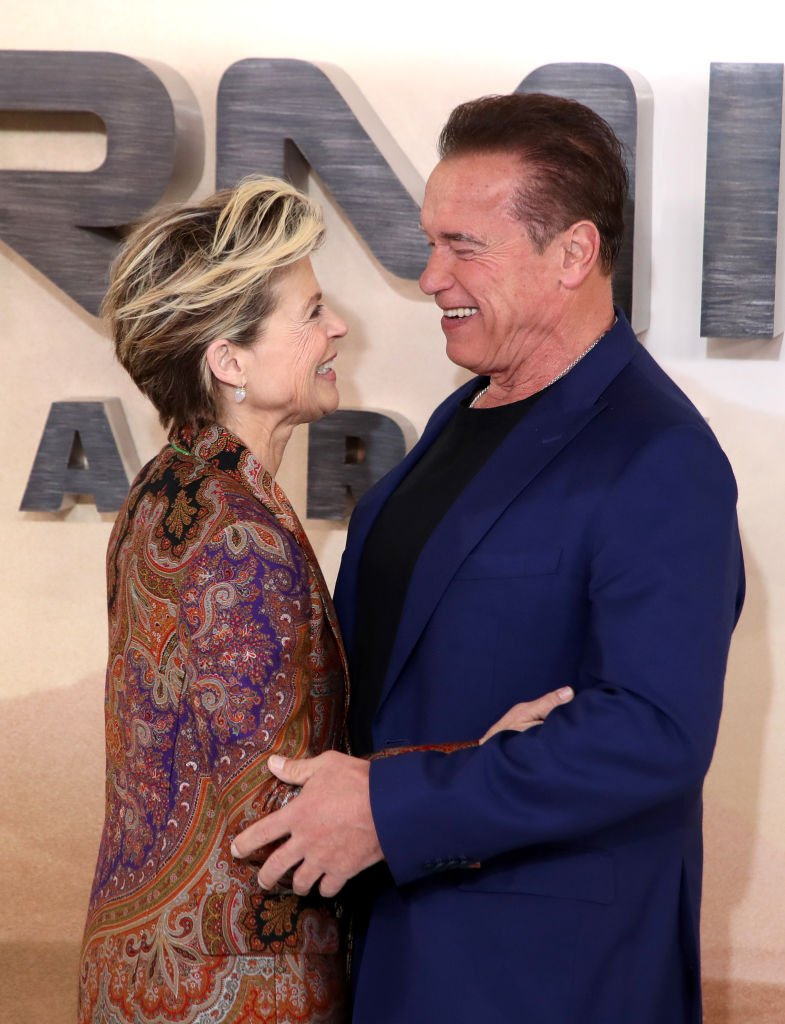 "Image Credits: Getty Images / Mike Marsland / WireImage | Linda Hamilton and Arnold Schwarzenegger attend the ""Terminator: Dark Fate"" photocall on October 17, 2019 in London, England."