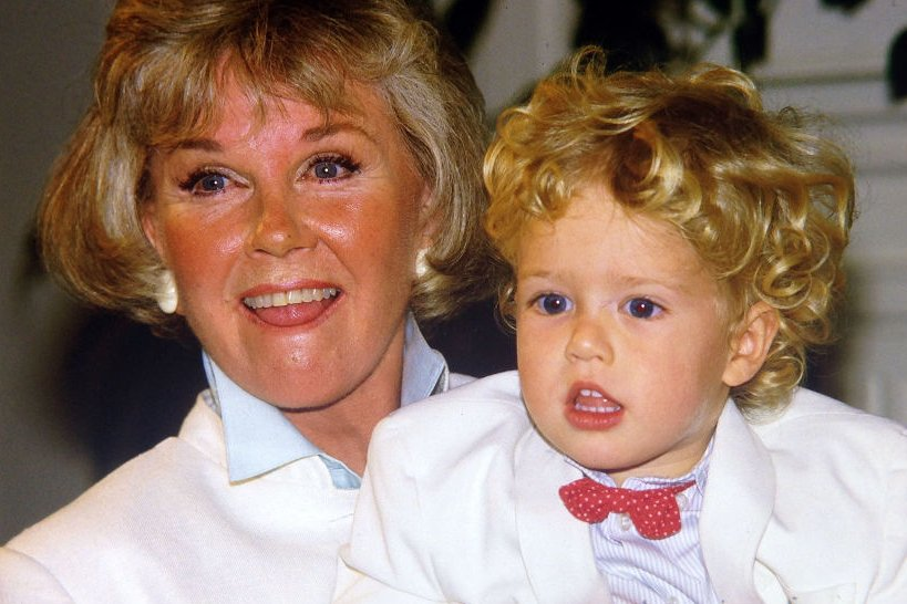 Image Credits: Getty Images / Paul Harris | Doris Day with her grandson Ryan Melcher 4, the son of her only child Terry Melcher at a press conference at the hotel she owns in Carmel, California July 16, 1985.