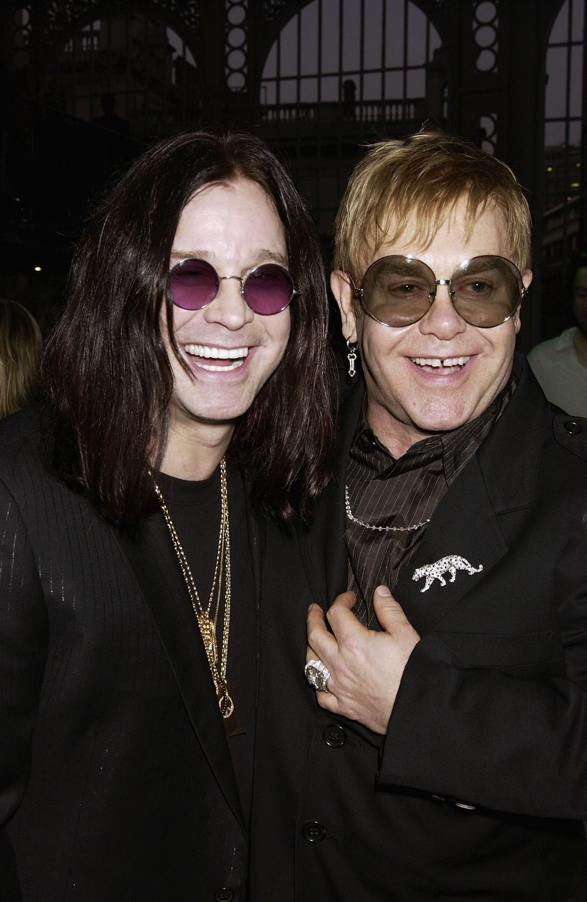 Image Credits: Getty Images / Elton John and Ozzy Osbourne smile for a photograph together.