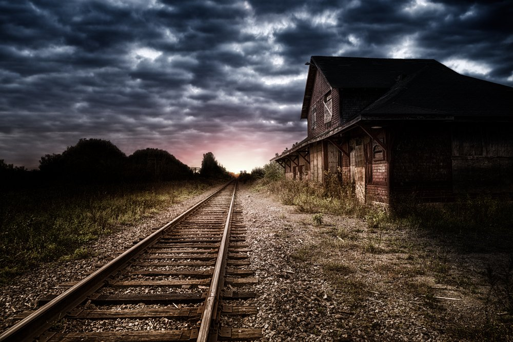 Empty and abandoned train station at night | Shutterstock