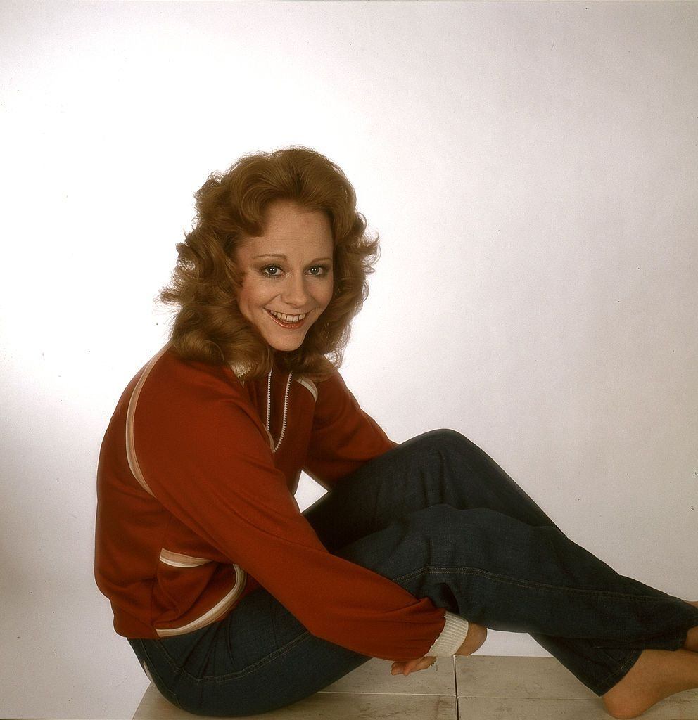 Image Credit: Getty Images / A young Reba McEntire poses for a portrait photograph.