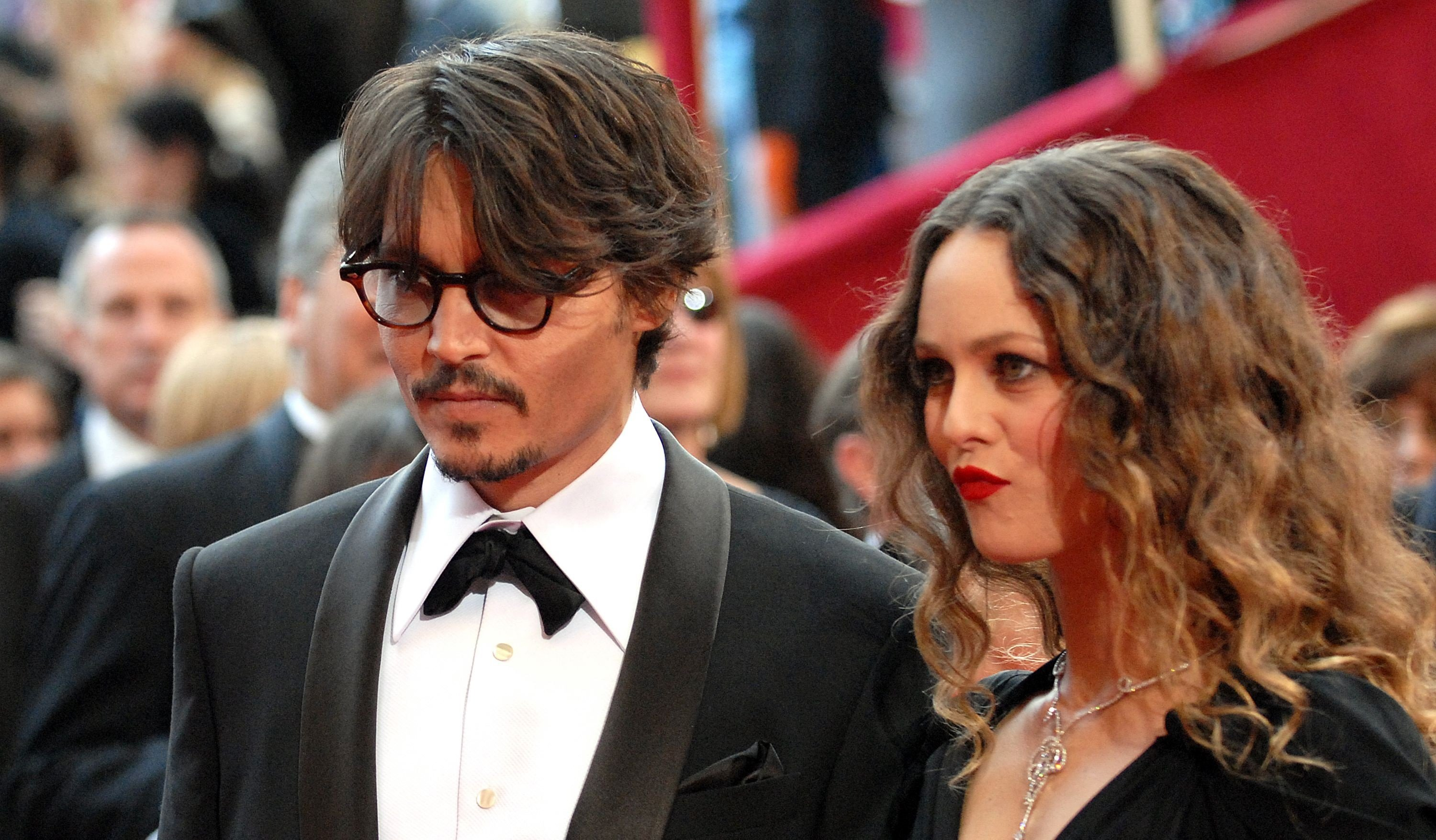 Johnny Depp and Vanessa Paradis arrive at the 80th annual Academy Awards / Getty Images