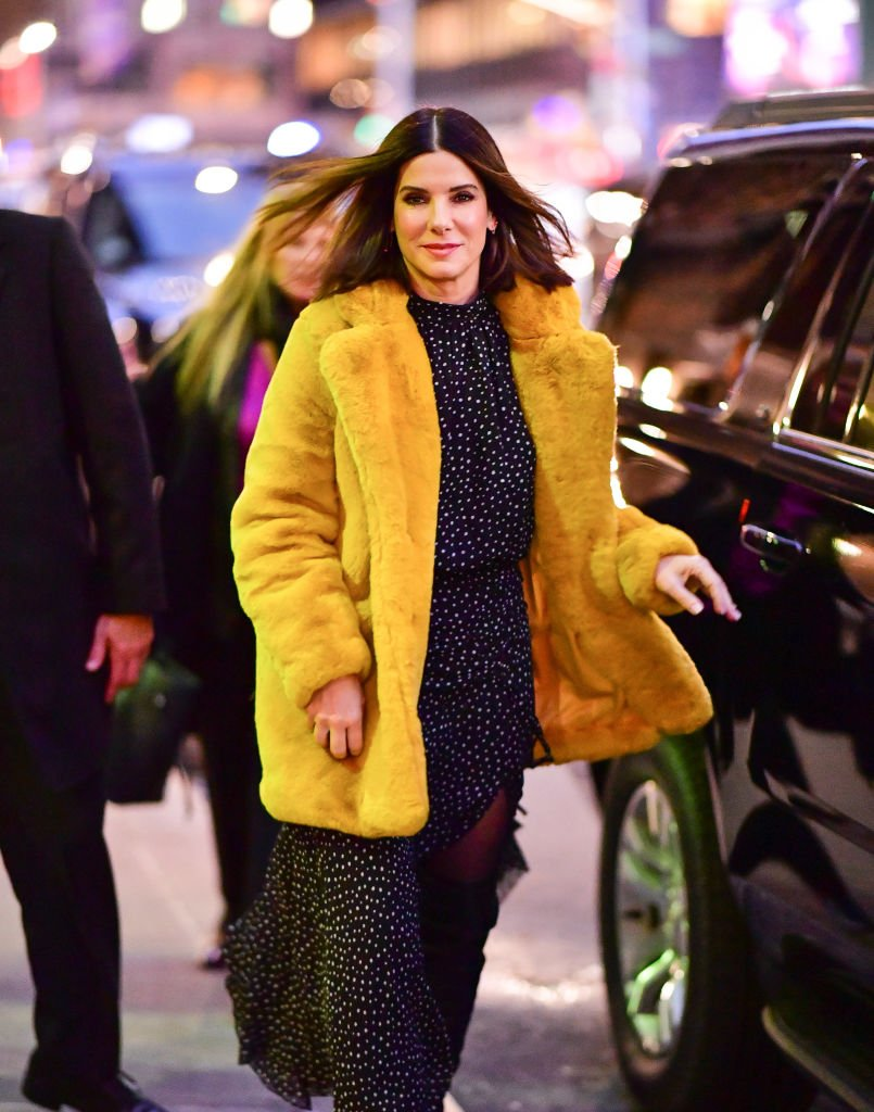 Image Credits: Getty Images / James Devaney / GC Images | Sandra Bullock arrives to 'The Late Show With Stephen Colbert' at the Ed Sullivan Theater on December 17, 2018 in New York City.