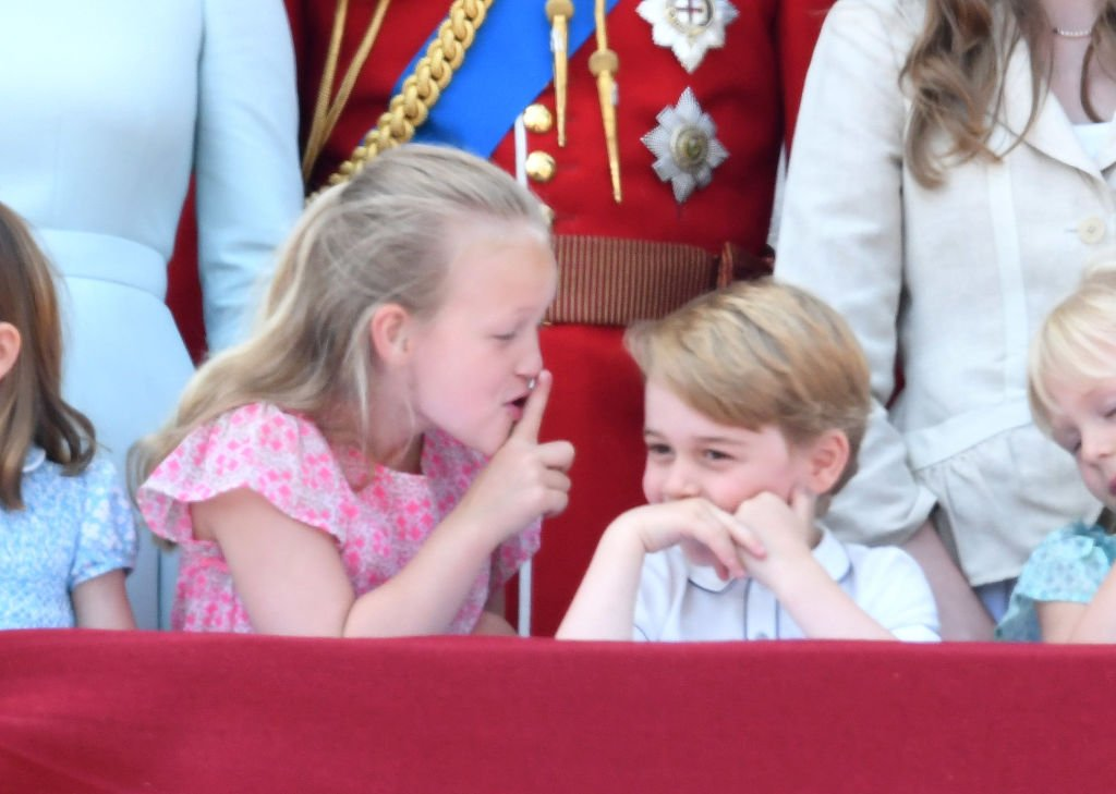 Image Credit: Getty Images / Savannah Phillips and Prince George stand on the balcony of Buckingham Palace during Trooping The Colour 2018 on June 9, 2018 in London, England.