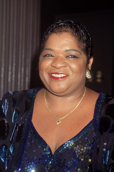 Image Credits: Getty Images / Victor Malafronte | American singer and actor Nell Carter smiles at her opening at Rainbows and Stars August 1, 1995 at Rockefeller Center in New York City.