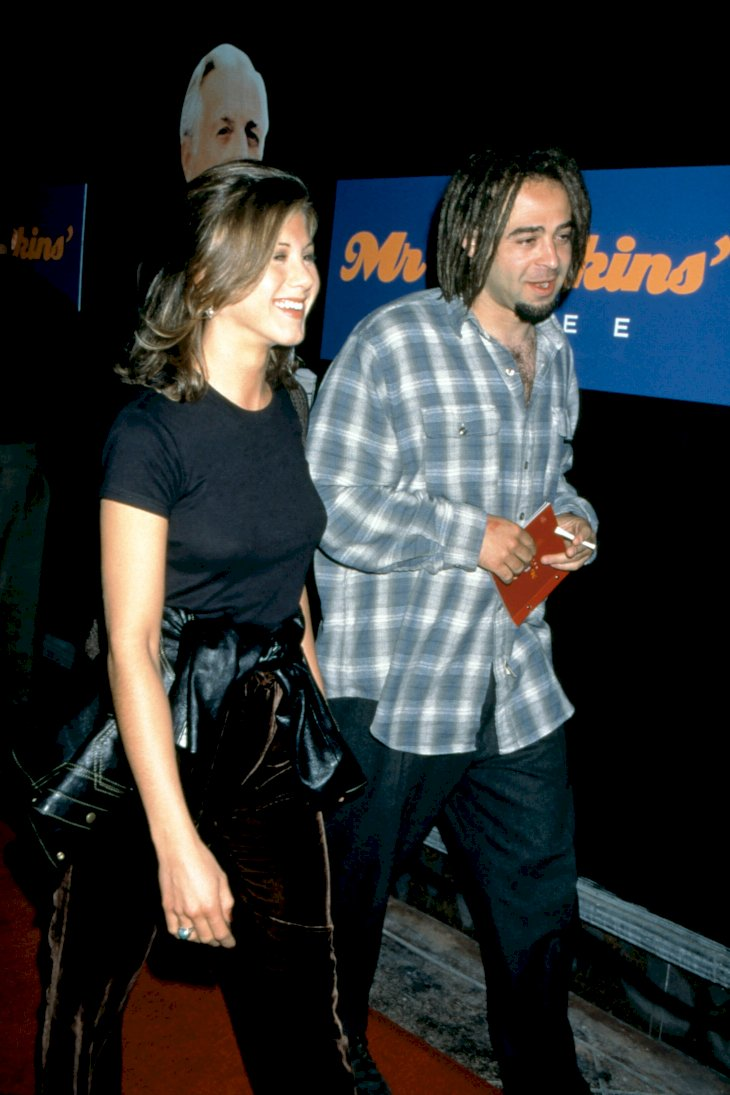 "Image Credit: Getty Images/Ron Davis | Jennifer Aniston and American musician Adam Duritz attend the ""Mr. Jenkins Soiree"""