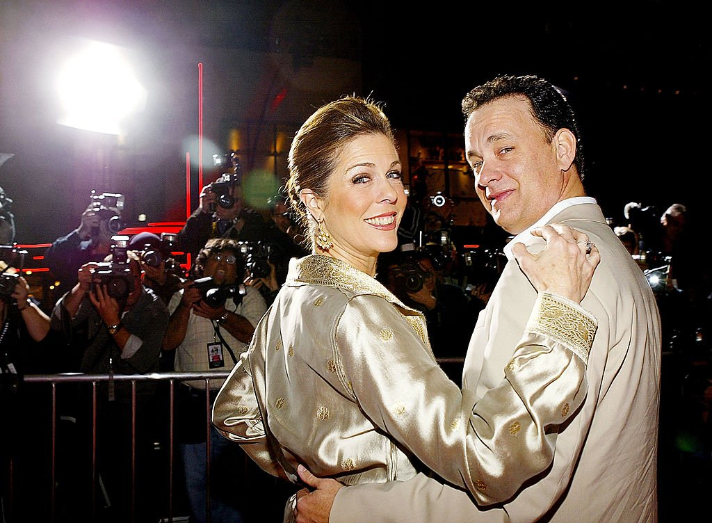 Image Credits: Getty Images / Carlo Allegri | Actor Tom Hanks (R) and actress Rita Wilson (L) arrive for the world premiere of the movie 'Ladykillers' at the El Capitan Theatre March 12, 2004 in Hollywood, CA. The movie goes into wide release on March 26th, 2004.