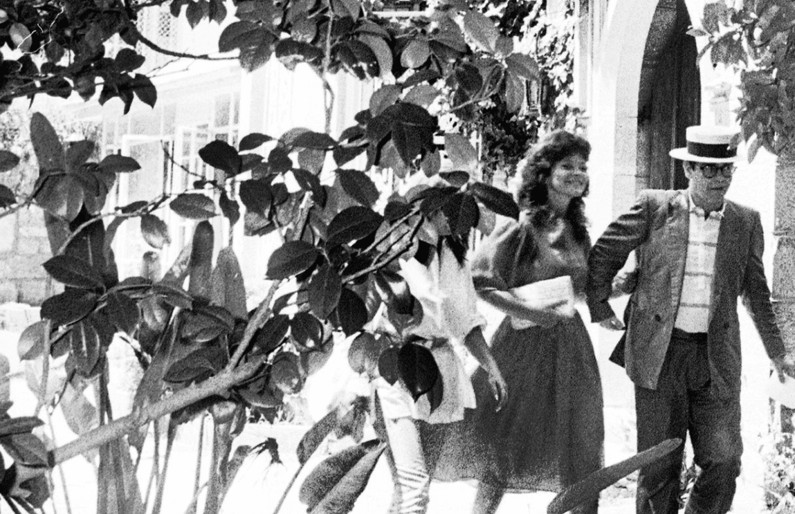 Image Credit: Getty Images / Renate Blauel and singer Elton John are seen outside St Mark's rectory two days before their wedding February 12, 1984 in Sydney, Australia.