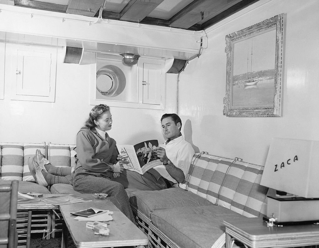 Image Source: Getty Images/George Rinhart/Errol Flynn and his wife, Nora Eddington, in the lounge of yacht, Zaca
