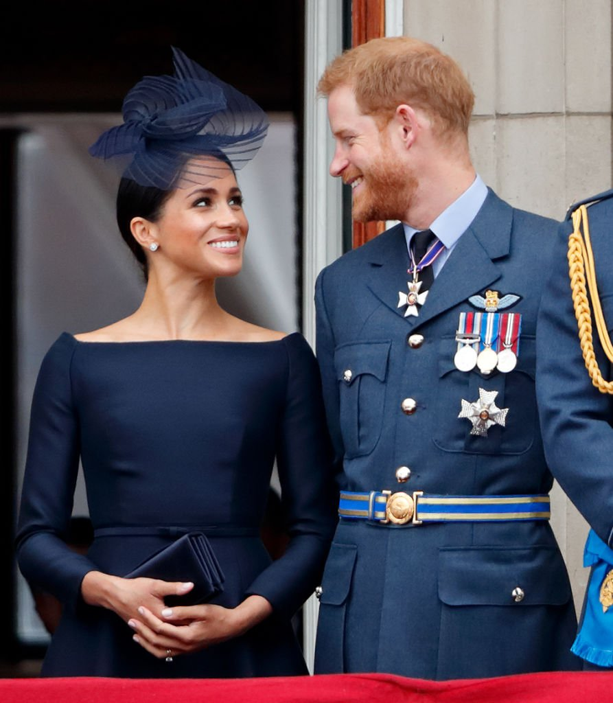 Image Credits: Getty Images / Max Mumby / Indigo | Meghan, Duchess of Sussex and Prince Harry, Duke of Sussex watch a flypast to mark the centenary of the Royal Air Force from the balcony of Buckingham Palace on July 10, 2018 in London, England. The 100th birthday of the RAF, which was founded on on 1 April 1918, was marked with a centenary parade with the presentation of a new Queen's Colour and flypast of 100 aircraft over Buckingham Palace.