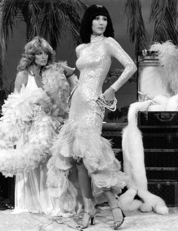 Image Source: Wikimedia Commons/Public Domain/Cher (right) with Farrah Fawcett on The Sonny & Cher Comedy Hour