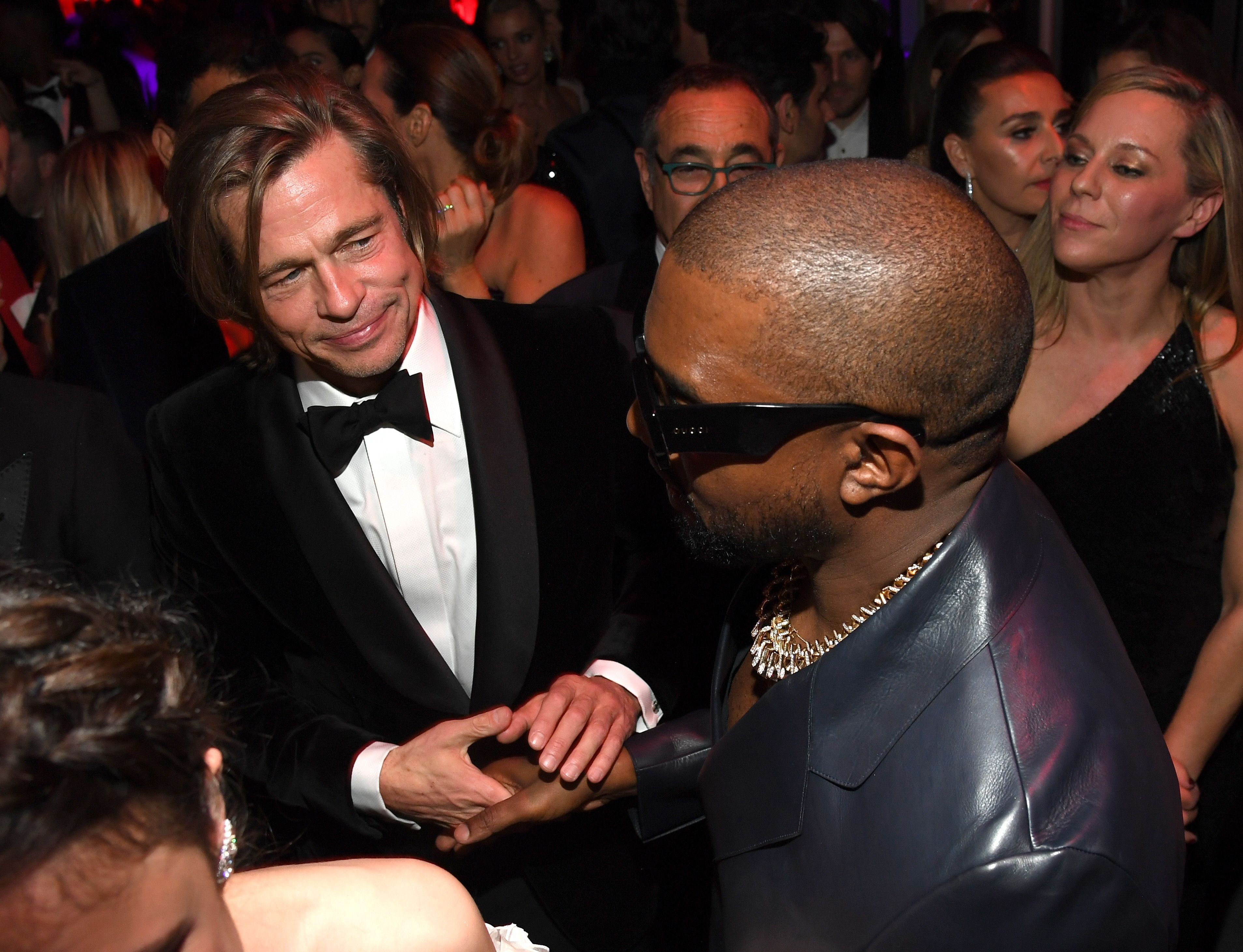 Brad Pitt and Kanye West / Getty Images
