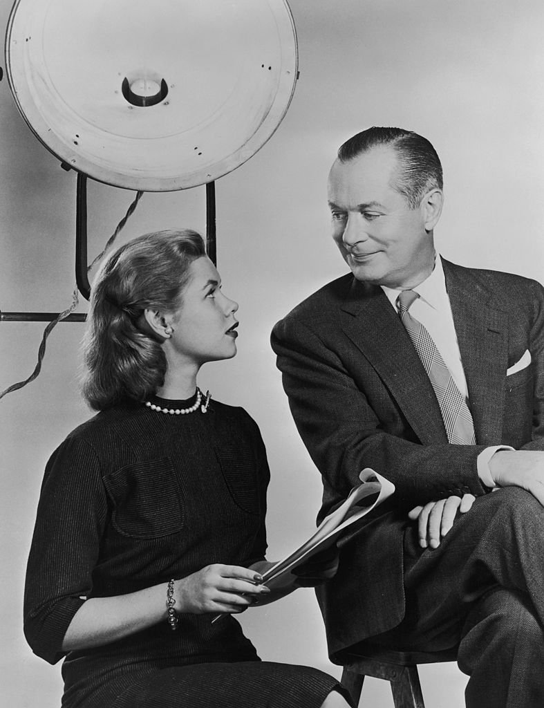 Image Credits: Getty Images / Archive Photos | American actor Robert Montgomery (1904 - 1981) on a film set with his daughter, actress Elizabeth Montgomery (1933 - 1995), circa 1960.