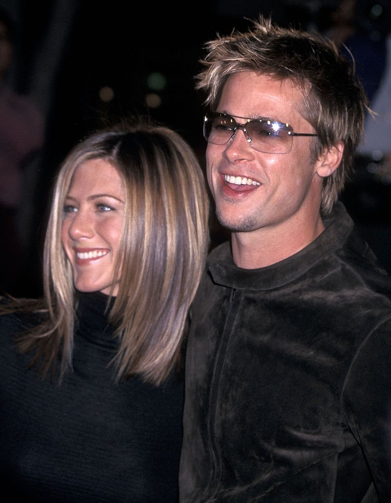 Image Credits: Getty Images / Ron Galella | Jennifer Aniston and Brad Pitt attend the 'Spy Game' Westwood Premiere on November 19, 2001 at Mann National Theatre in Westwood, California.