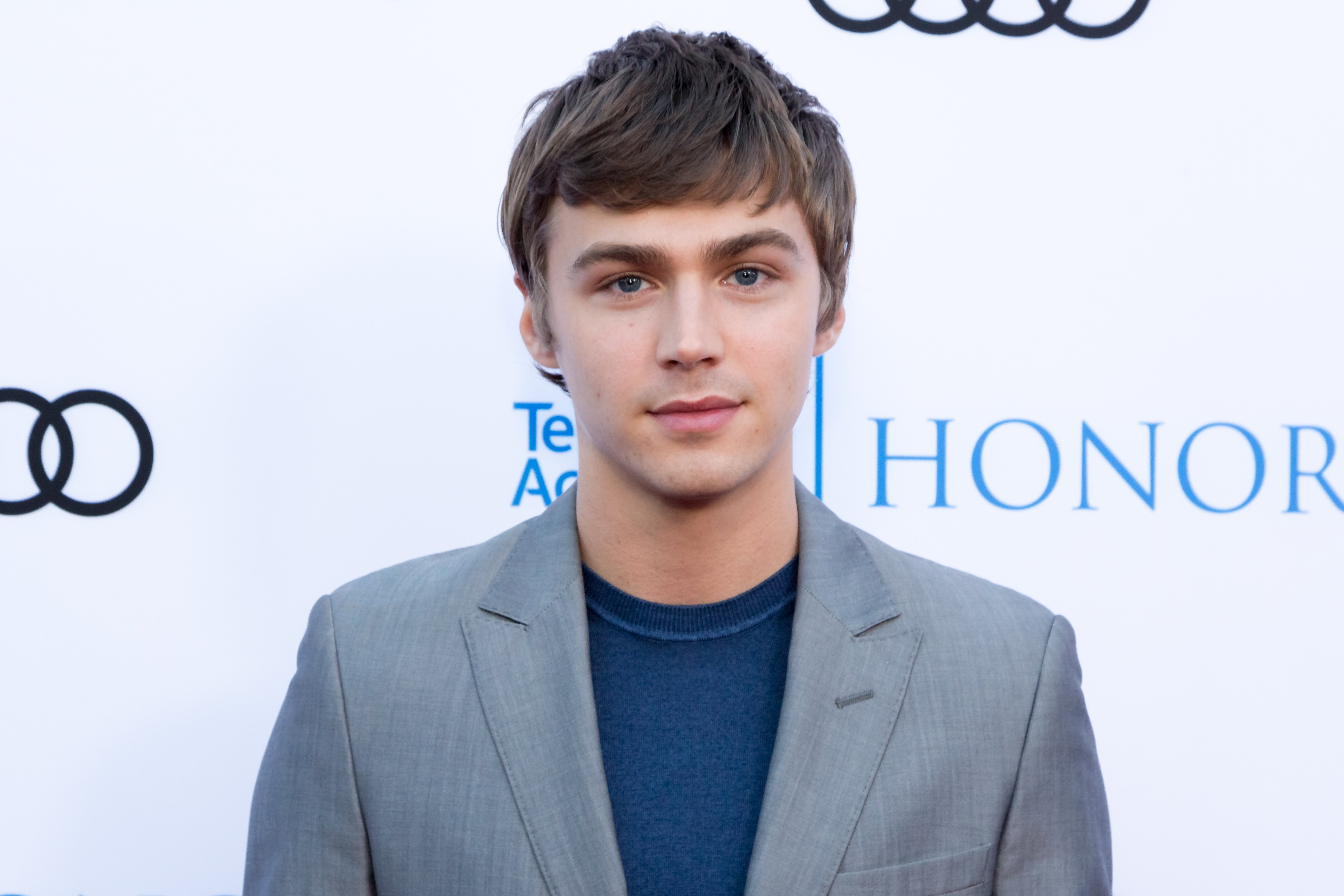Image Source: Getty Images| Miles Heizer having an interview at the Television Academy Honors