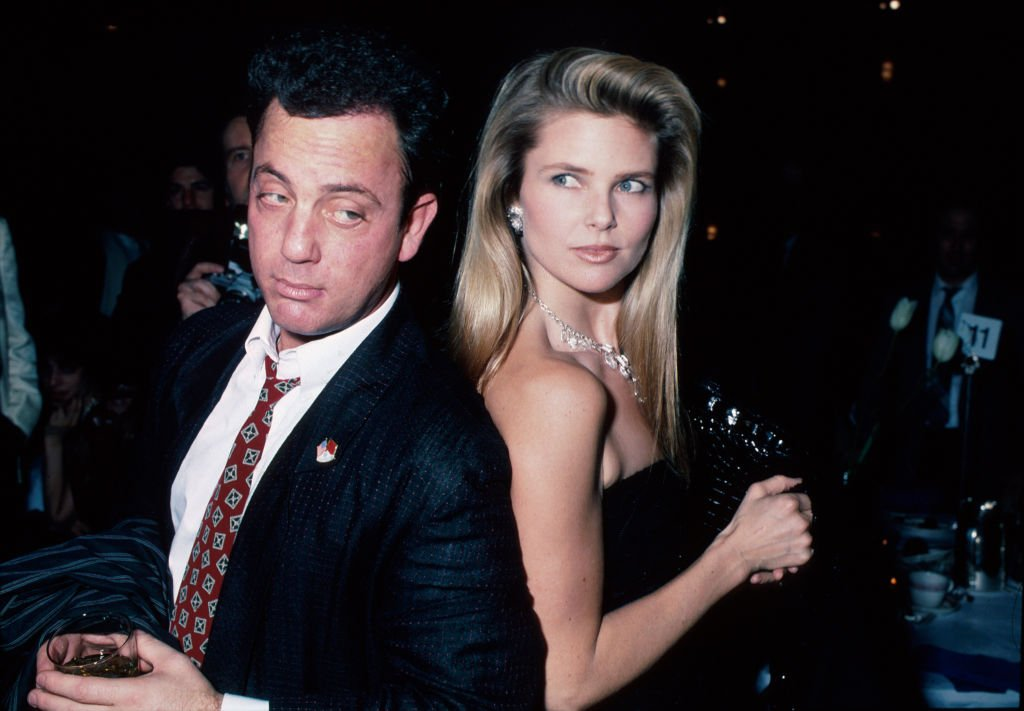 Image Credits: Getty Images / Ann Clifford / DMI / The LIFE Picture Collection | Singer/songwriter Billy Joel and wife, model Christie Brinkley.