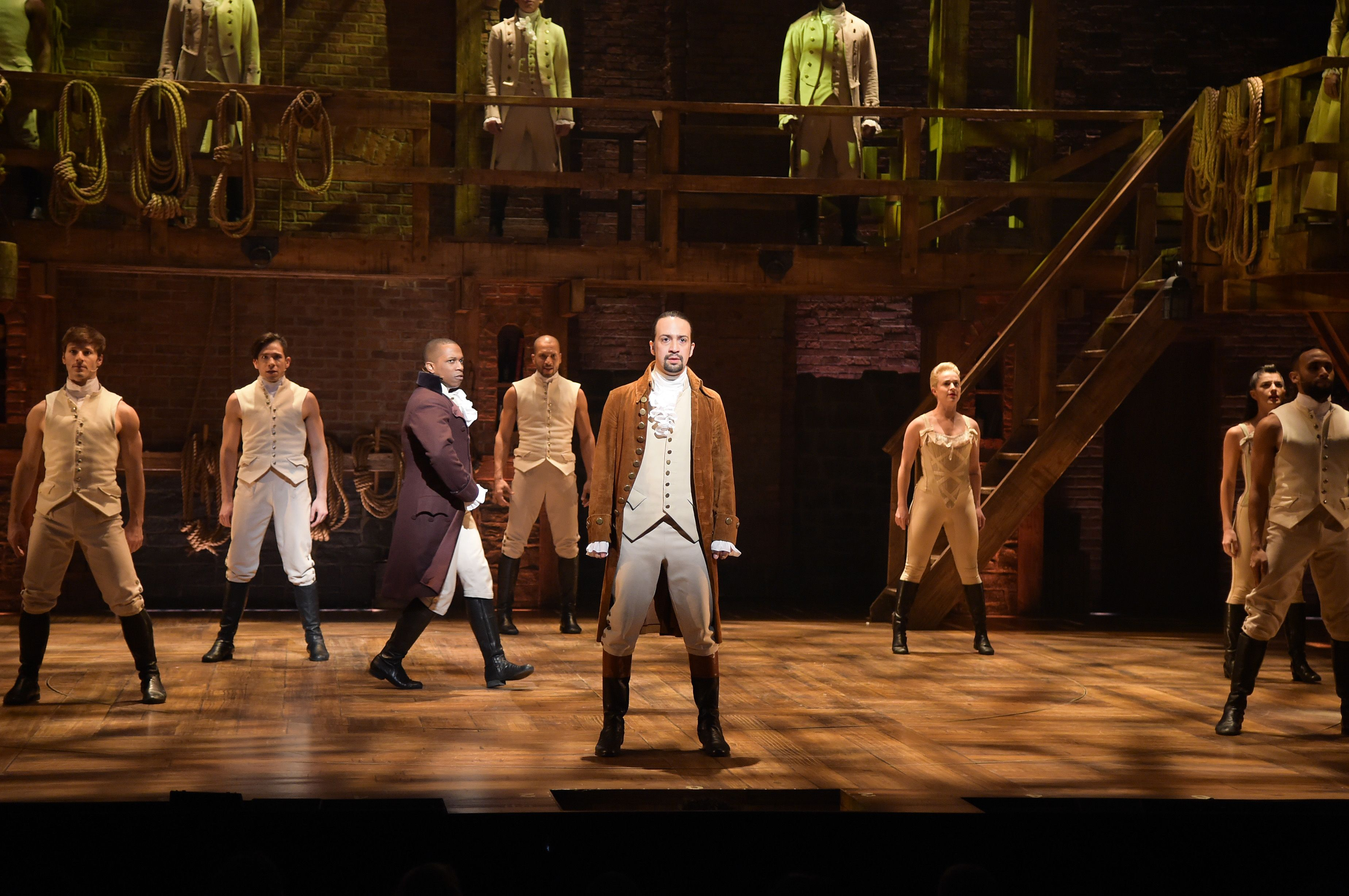 """Actor, composer Lin-Manuel Miranda and cast of """"Hamilton"""" perform on stage during """"Hamilton"""" GRAMMY performance / Getty Images"""
